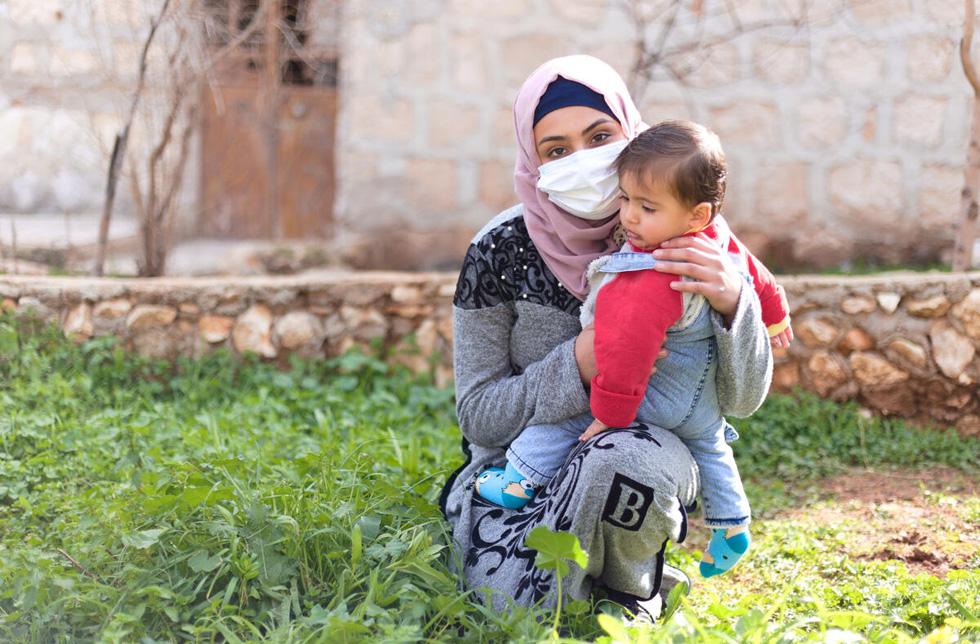 Fille syrienne avec enfant.